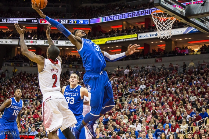 Nerlens Noel snags a rebound over Russ Smith.