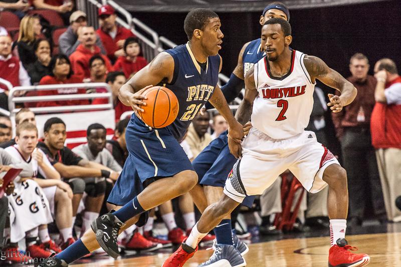 Louisville's Russ Smith keeps a close eye on Lamar Patterson.