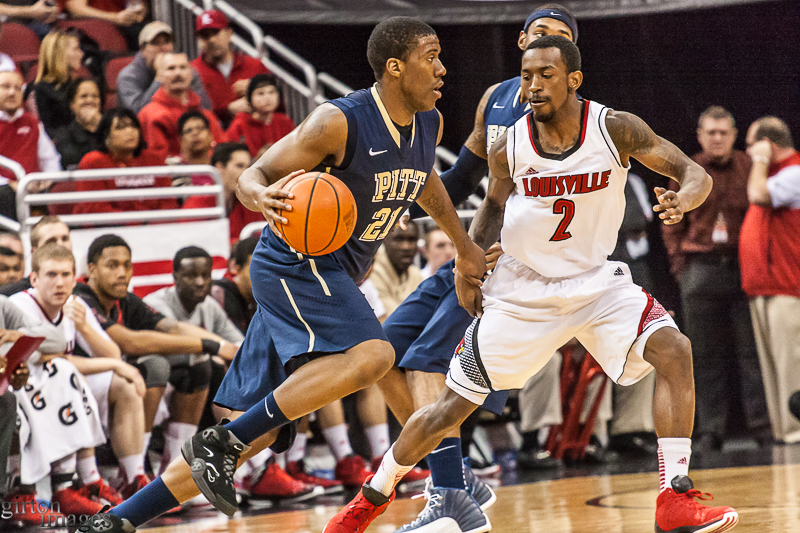 Louisville's Russ Smith keeps a close eye on Lamar Patterson.