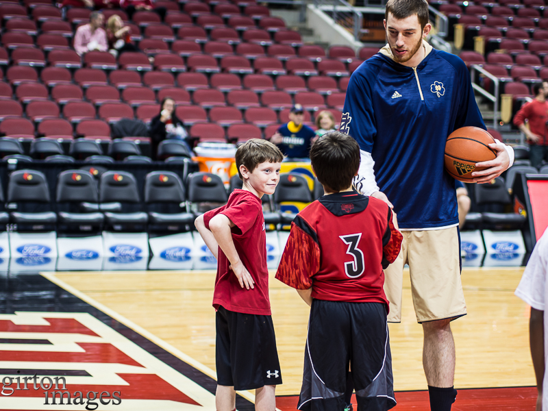 One of the Notre Dame players talks to the UofL ball boys.
