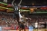 Russ Smith throws a pass with David Nyarsuk (33) and Sean Kilpatrick (23) challenging him.