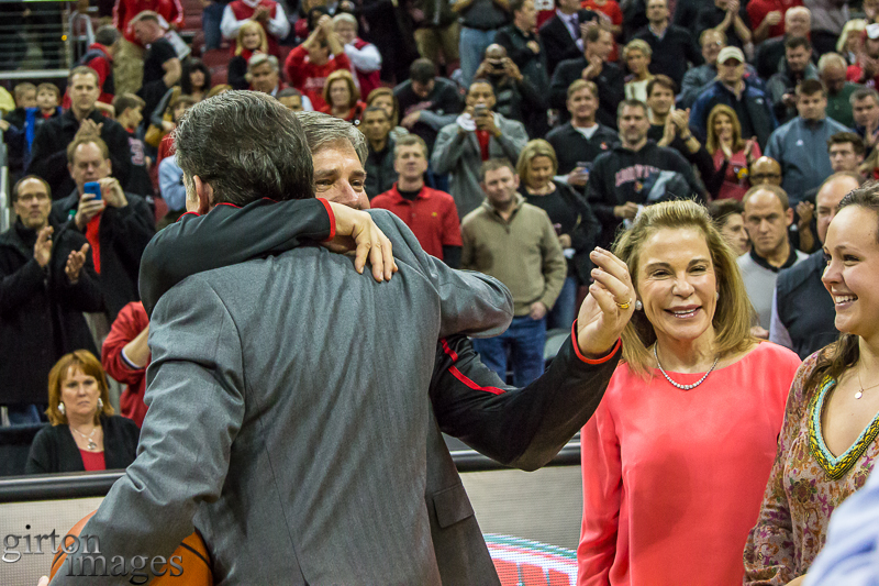 Rick Pitino and Tom Jurich embrace to celebrate the coach's 300th win at Louisville.