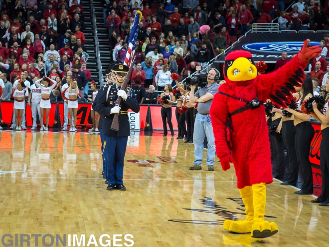 Louie the Cardinal escorting the color guard.